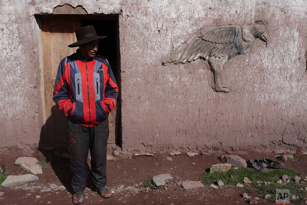 In this March 2, 2018 photo, Miguel Rocco stands in front of his home in Pitumarca, Peru. (AP Photo/Martin Mejia)