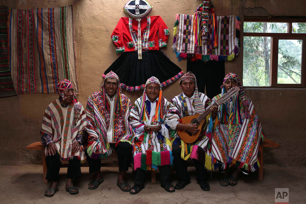 In this April 4, 2018 photo, a group of musicians pose for a portrait in Pitumarca, Peru, near Rainbow Mountain. (AP Photo/Martin Mejia)