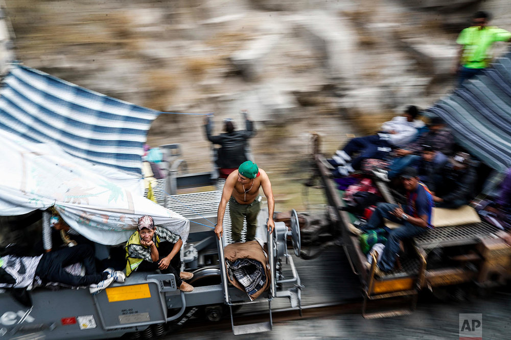 "Central American migrants, who attended the annual Migrants Stations of the Cross caravan for migrants' rights, ride a northern-bound train known as ""La Bestia,"" or The Beast, as they arrive to Hermosillo, Sonora state, Mexico, Saturday, April 21, 2018. The remnants of the migrant caravan that drew the ire of President Donald Trump were continuing their journey north through Mexico toward the U.S. border. (AP Photo/Luis Gutierrez)"