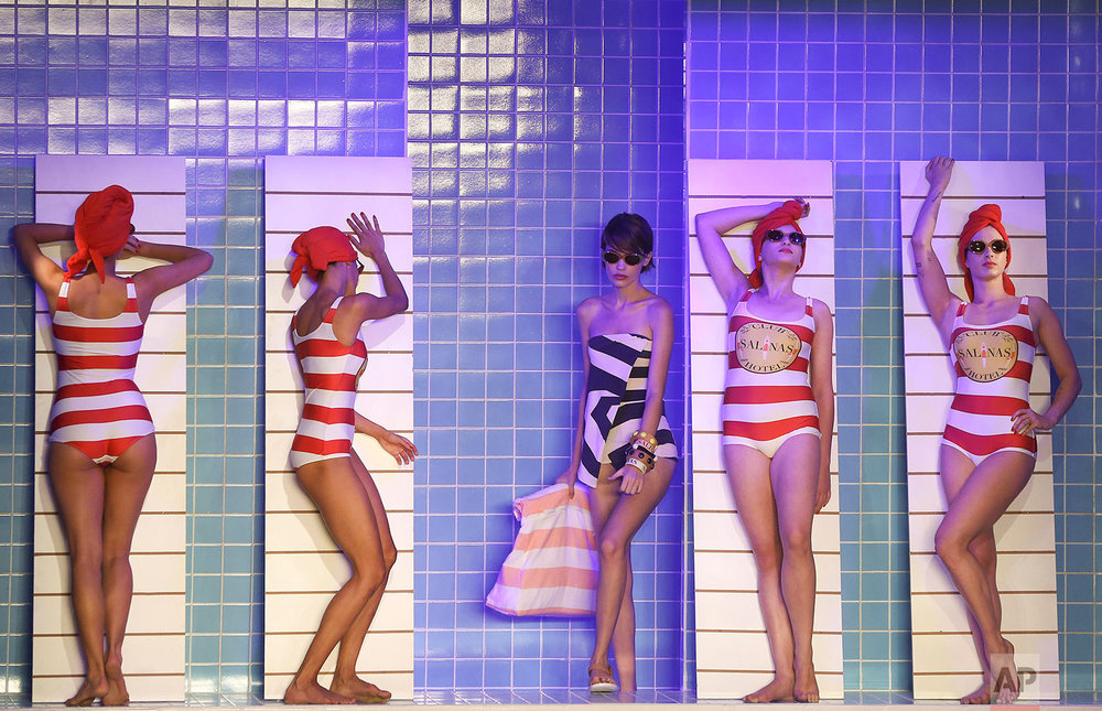 Models pretend to rest on chairs as they stand in creations from the Salinas collection during Sao Paulo Fashion Week in Sao Paulo, Brazil, Wednesday, April 25, 2018. (AP Photo/Andre Penner)