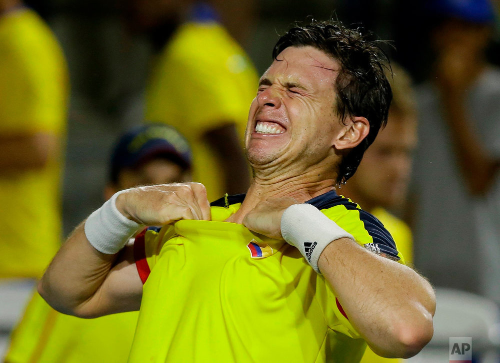 Colombia's Alejandro Gonzalez celebrates after defeating Brazil's Joao Pedro Sorgi, in a Davis Cup World Group playoffs tennis match in Barranquilla, Colombia, April 7, 2018. Colombia won the series 3-2. (AP Photo/Fernando Vergara)