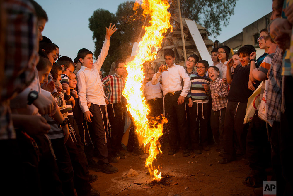 Ultra-Orthodox Jewish youths play with fire during the Jewish holiday of Lag Ba'Omer in Bnei Brak, Israel, Wednesday, May 2, 2018. The holiday marks the end of a plague said to have decimated Jews during the Roman times. (AP Photo/Oded Balilty)