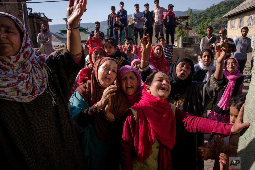 Mourners for Mohammad Asgar, one among three civilians killed, wail during his funeral in Baramulla, 60 kilometers (37 miles) west of Srinagar, Indian controlled Kashmir, Tuesday, May 1, 2018. Suspected militants shot and killed three men in Indian-controlled Kashmir, police said on Tuesday. (AP Photo/Dar Yasin)