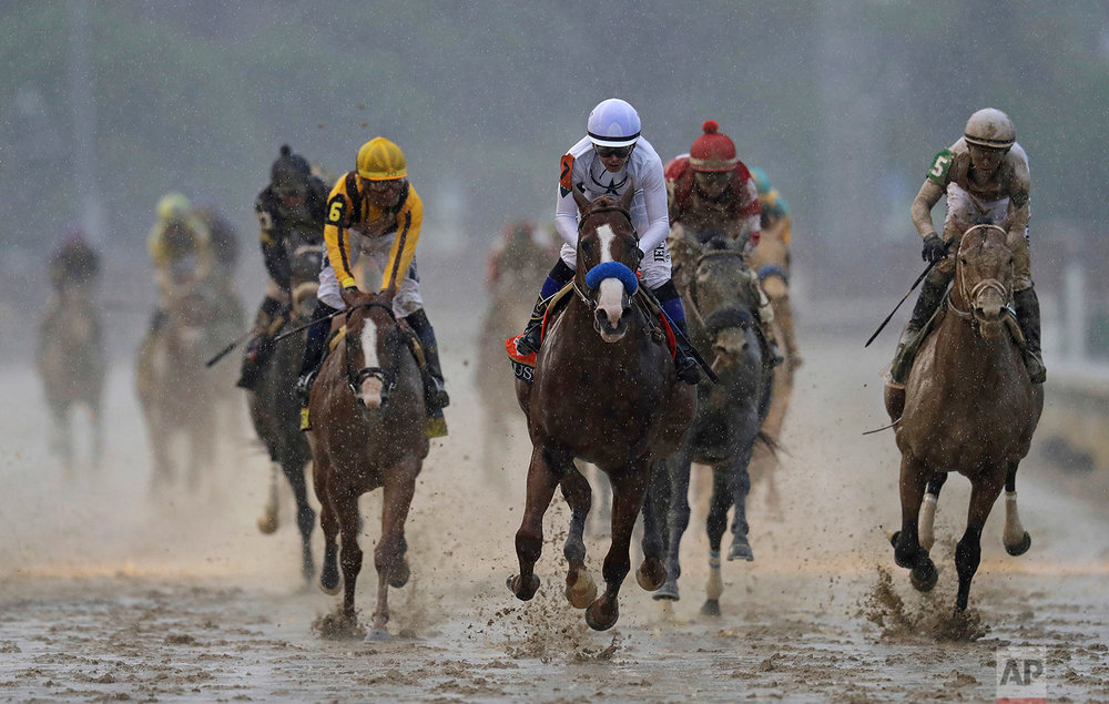 Mike Smith rides Justify to victory during the 144th running of the Kentucky Derby horse race at Churchill Downs Saturday, May 5, 2018, in Louisville, Ky. (AP Photo/Darron Cummings)