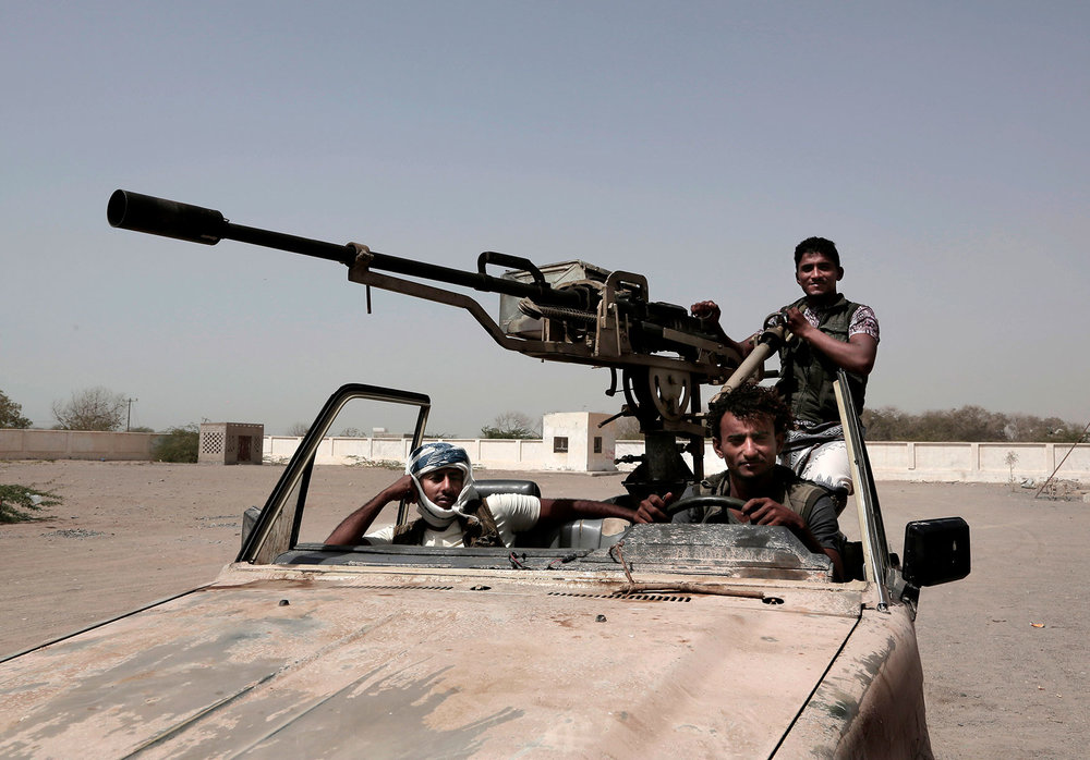 n this Feb. 12, 2018 photo, young Saudi-led backed forces, part of Ahmed Al-Kawkabani's southern resistance unit in Hodeida, petrol al-Khoukha, Yemen. (AP Photo/Nariman El-Mofty)