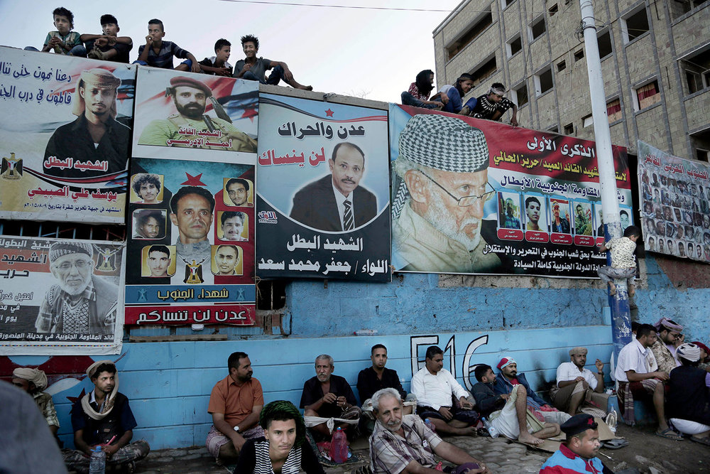 In this Feb. 16, 2018 photo, youth gather in martyrs square during the seventh anniversary of the independence of the South from the rule of Ali Abdullah Saleh in Aden, Yemen. (AP Photo/Nariman El-Mofty)