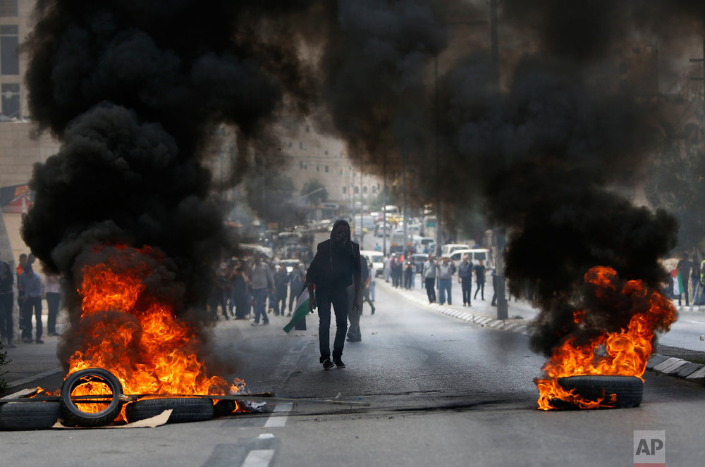 Palestinians clash with Israeli troops following a protest against the U.S. decision to relocate it's Israeli embassy to Jerusalem, in the West Bank city of Bethlehem, Monday, May 14, 2018. (AP Photo/Majdi Mohammed)
