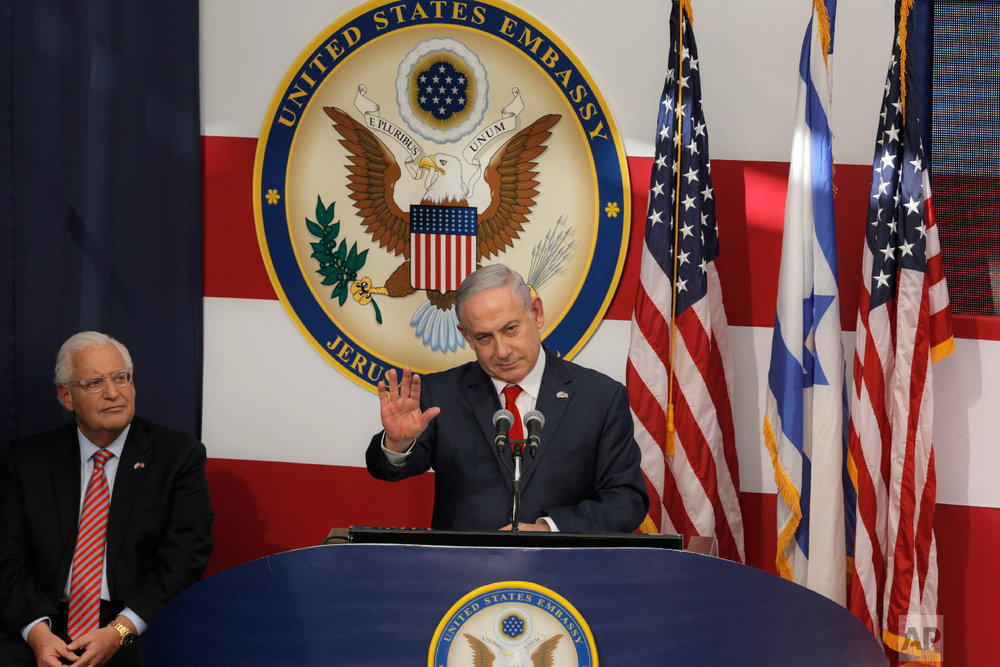 Israeli Prime Minister Benjamin Netanyahu speaks as U.S. Ambassador to Israel David Friedman listens during the opening ceremony of the new US embassy in in Jerusalem, Monday, May 14, 2018. (AP Photo/Sebastian Scheiner)
