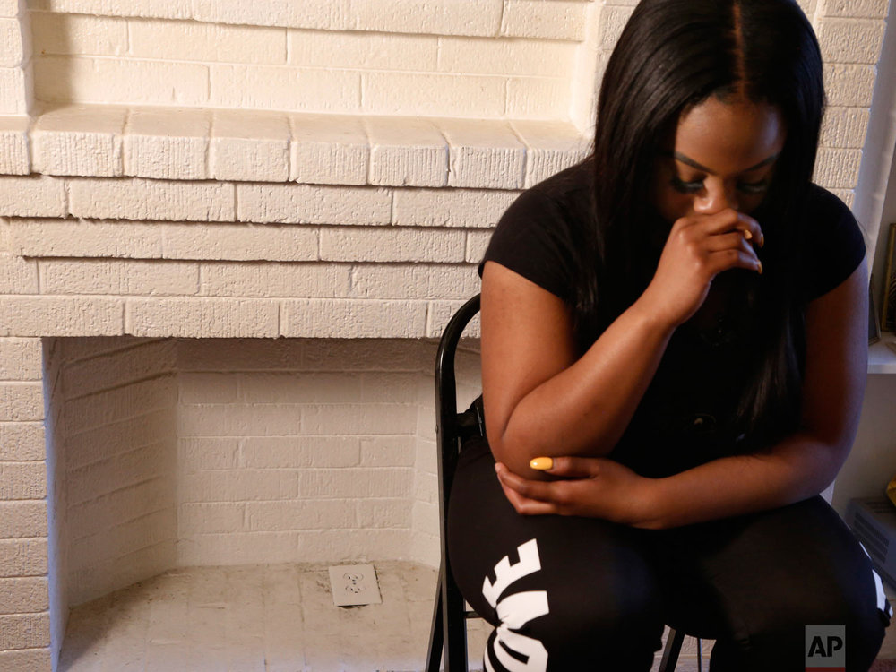 "Alexis Willis fights back tears after talking about her cousin, Jaheim Wilson, at her Chicago home on Thursday, April 26, 2018. Wilson was shot and killed less than three weeks earlier as he walked with a friend in Chicago. ""Nobody that's 16 should have to die,"" she said. Willis, who has joined a group at her school that advocates the Rev. Martin Luther King Jr.'s ""Six Principles of Nonviolence,"" worries about her own safety. (AP Photo/Martha Irvine)"