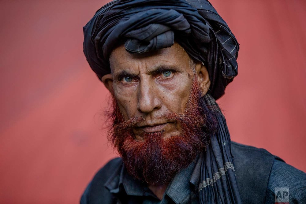 In this May 9, 2018, photo, Dawood Khatana, a Kashmiri nomadic Bakarwal poses for a photograph at a camp in Newa, 29 kilometers (18 miles) south of Srinagar, Indian controlled Kashmir. (AP Photo/Dar Yasin)
