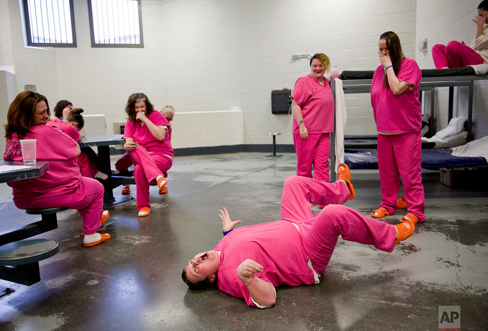 Blanche Ball performs her rendition of a turtle on its back for cellmates at the Campbell County Jail in Jacksboro, Tenn., Tuesday, March 20, 2018. (AP Photo/David Goldman)