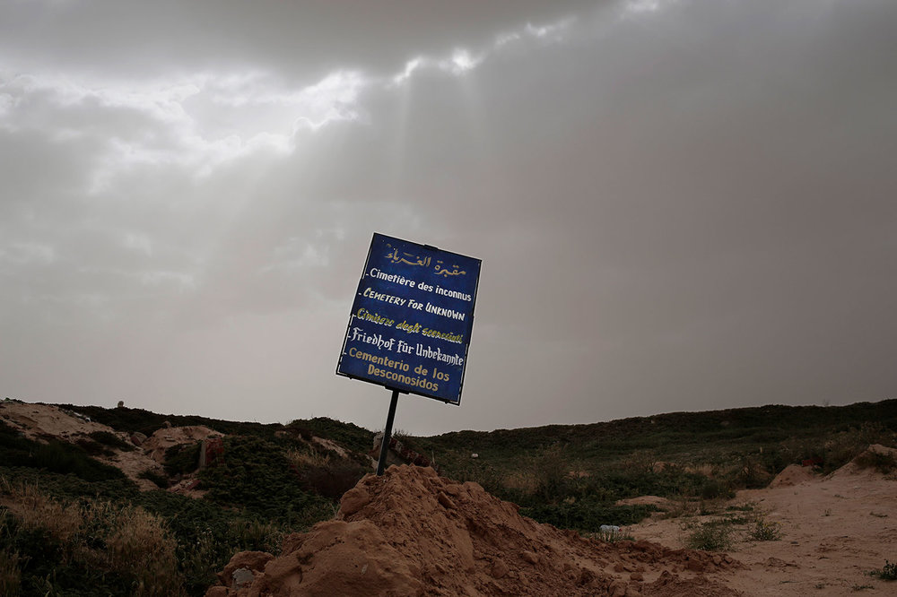 """This Sunday, April 15, 2018 photo shows the """"Cemetery of the Unknown,"""" where migrants who were found dead on nearby shores are buried, in the port town of Zarzis, Tunisia. (AP Photo/Nariman El-Mofty)"""