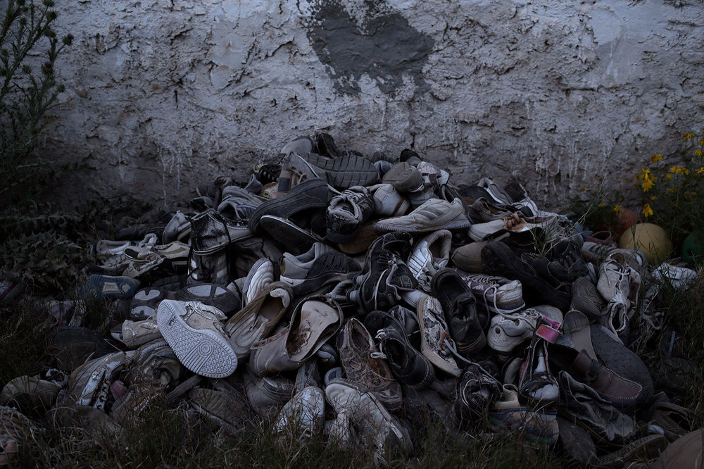 In this April 15, 2018 photo,  migrants shoes which were collected by artist Mohsen Lahzib at his space, at the southern port town of Zarzis, Tunisia. (AP Photo/Nariman El-Mofty)