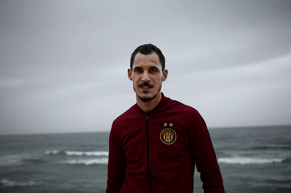 In this Saturday, April 14, 2018 photo, Khaled Arfawy, 25, who wants to leave Tunisia, poses at the beach where migrants leave for Italy, in Ras Jabal, Tunisia. (AP Photo/Nariman El-Mofty)