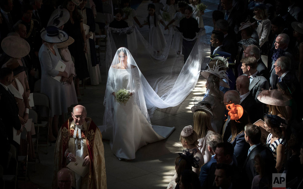 Meghan Markle walks down the aisle as she arrives for her wedding to Britain's Prince Harry at St. George's Chapel in Windsor Castle in Windsor, near London, England, Saturday, May 19, 2018. (Danny Lawson/pool photo via AP)