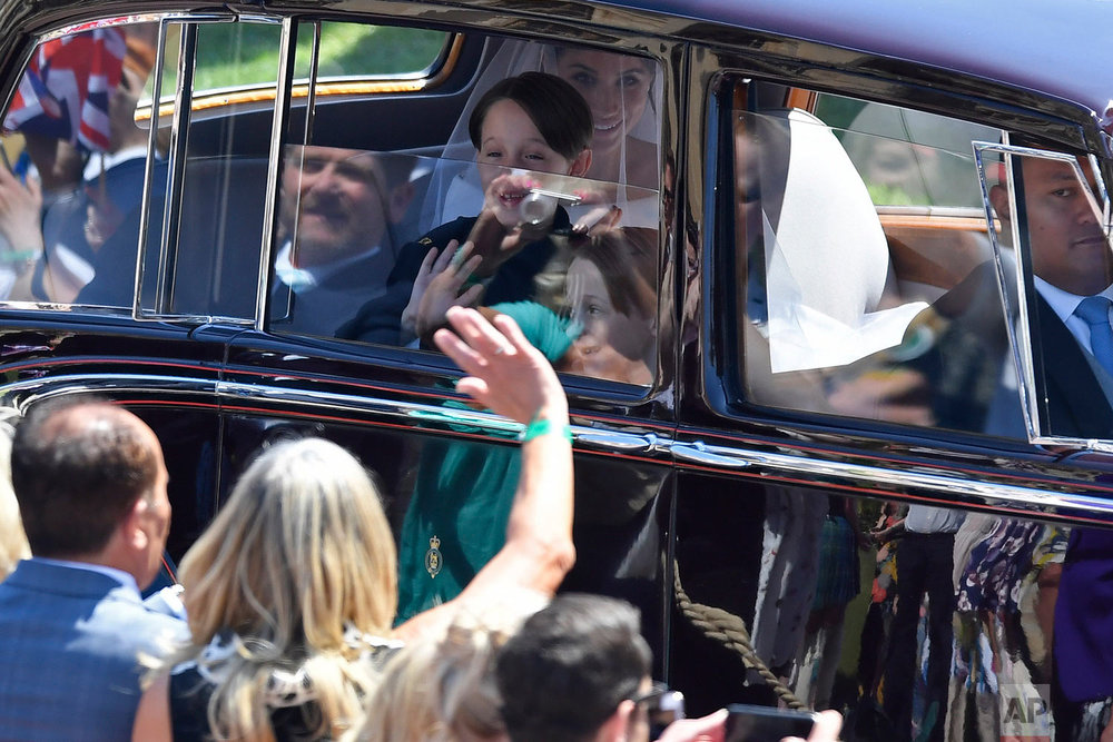 Meghan Markle is driven with some of her page boys to the wedding ceremony at St. George's Chapel in Windsor Castle in Windsor, near London, England, Saturday, May 19, 2018. (Toby Melville/pool photo via AP)