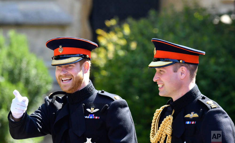 Britain's Prince Harry, left, reacts as he walks with his best man, Prince William the Duke of Cambridge, as they arrive for the the wedding ceremony of Prince Harry and Meghan Markle at St. George's Chapel in Windsor Castle in Windsor, near London, England, Saturday, May 19, 2018. (Ben Birchhall/pool photo via AP)