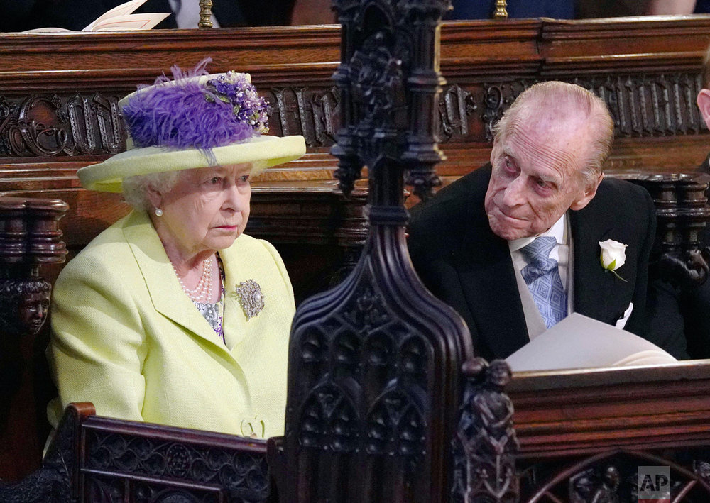 Britain's Queen Elizabeth and Prince Phillip attend the wedding ceremony of Prince Harry and Meghan Markle at St. George's Chapel in Windsor Castle in Windsor, near London, England, Saturday, May 19, 2018. (Jonathan Brady/pool photo via AP)