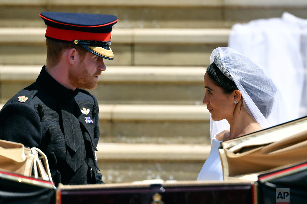 Britain's Prince Harry and his wife Meghan Markle after their wedding ceremony at St. George's Chapel in Windsor Castle in Windsor, near London, England, Saturday, May 19, 2018. (Ben Stansall/pool photo via AP)