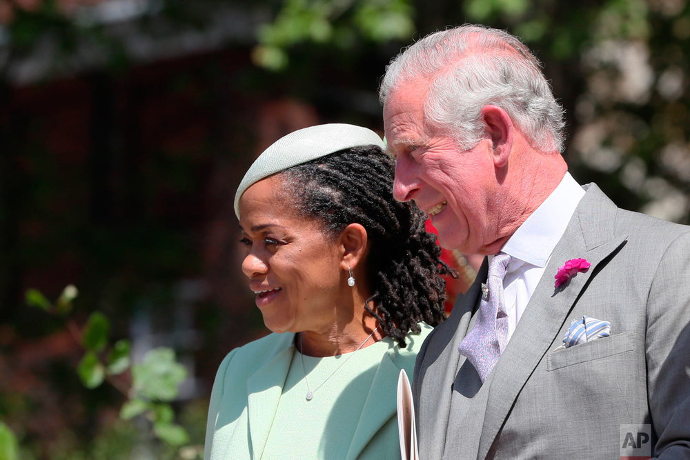 Doria Ragland and Prince Charles leave after the wedding ceremony of Prince Harry and Meghan Markle at St. George's Chapel in Windsor Castle in Windsor, near London, England, Saturday, May 19, 2018. (Brian Lawless/pool photo via AP)