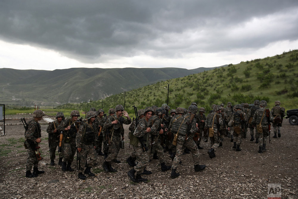 In this Friday, May 11, 2018, soldiers leave a military area after a shooting practice at Mataghis army base.  (AP Photo/Thanassis Stavrakis)