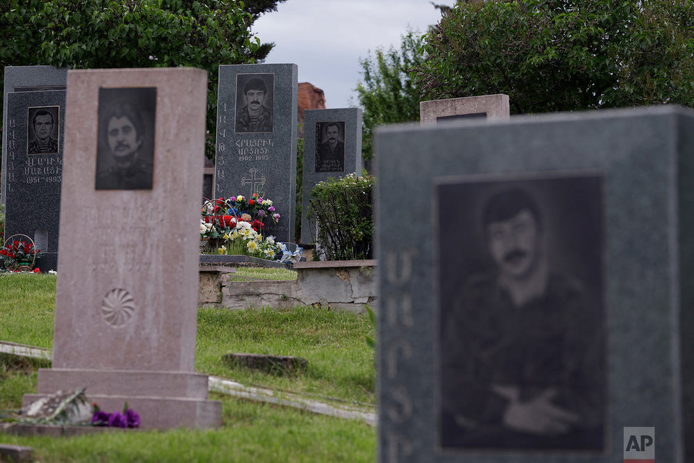 In this Thursday, May 10, 2018, a soldier cemetery with the victims of 1988-1994 war is seen in Stepanakert.  (AP Photo/Thanassis Stavrakis)