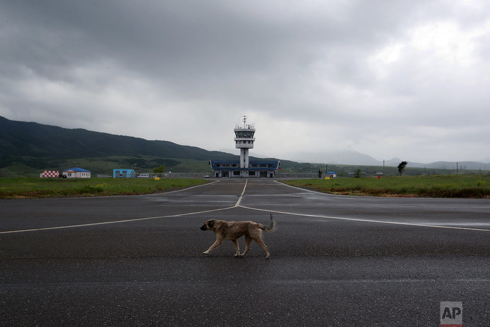 In this Friday, May 11, 2018, a dog walks on  the empty runway of Stepanakert airport. (AP Photo/Thanassis Stavrakis)