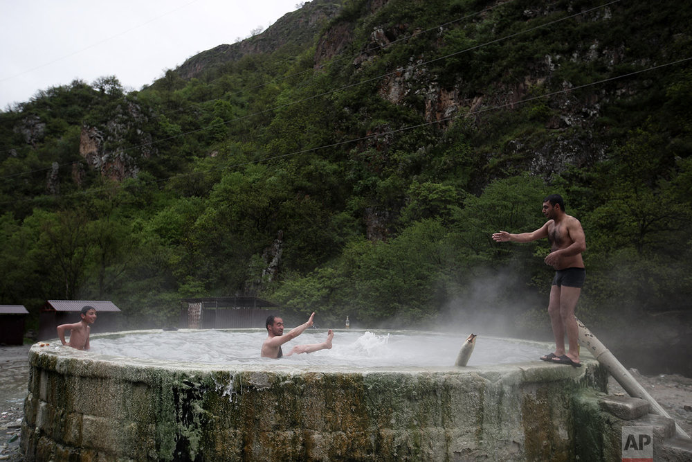 In this Saturday, May 12, 2018, local residents enjoy thermal springs in Karvachar. (AP Photo/Thanassis Stavrakis)