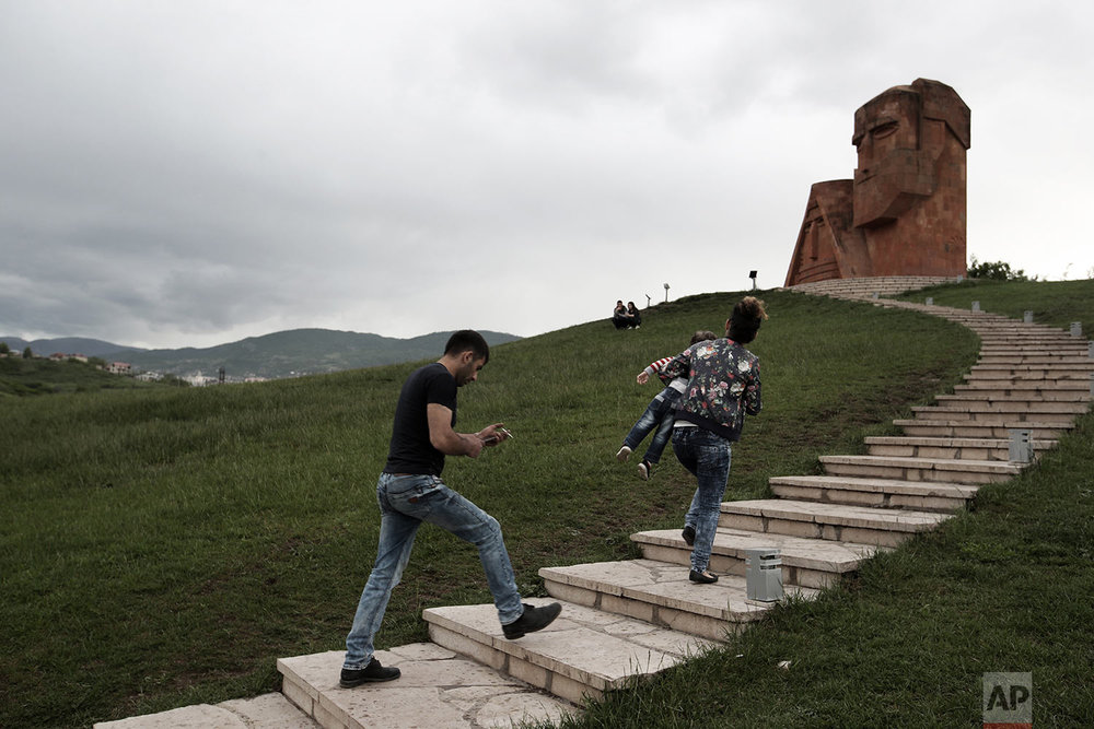 In this Friday, May 11, 2018, people visit the monument ''We are our mountains'' in Stepanakert. (AP Photo/Thanassis Stavrakis)