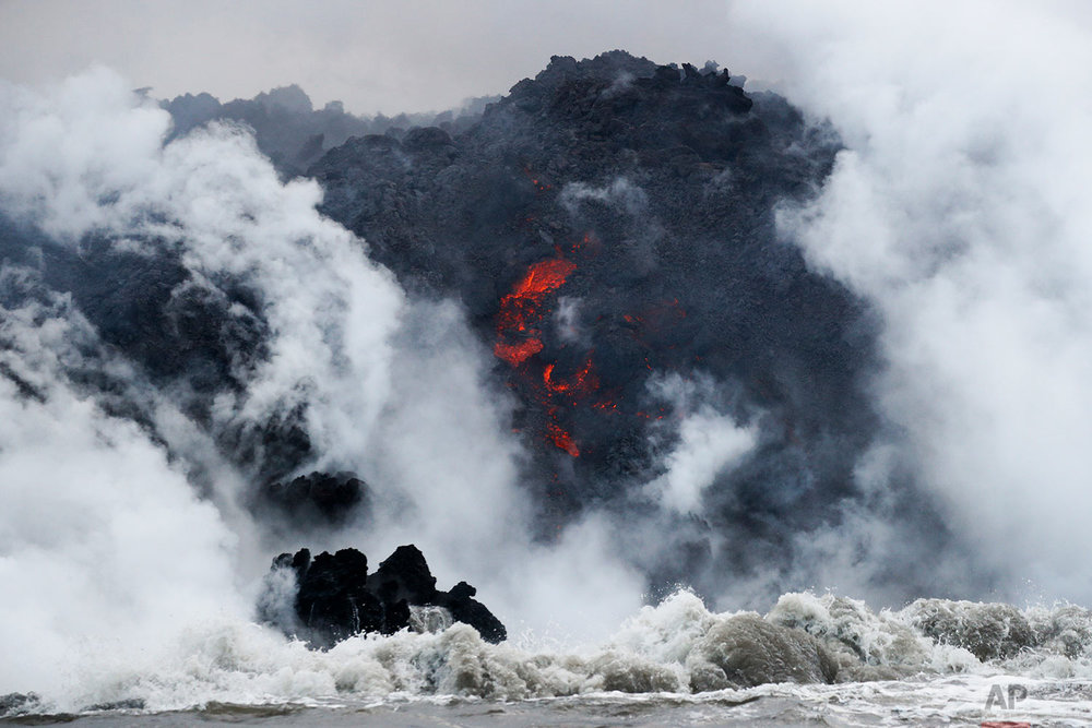 Lava flows into the ocean near Pahoa, Hawaii, May 20, 2018. (AP Photo/Jae C. Hong)