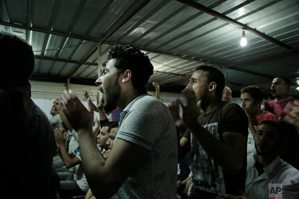 Cheering fans watch the Liverpool vs Roma match in Nagrig. (AP Photo/Nariman El-Mofty)