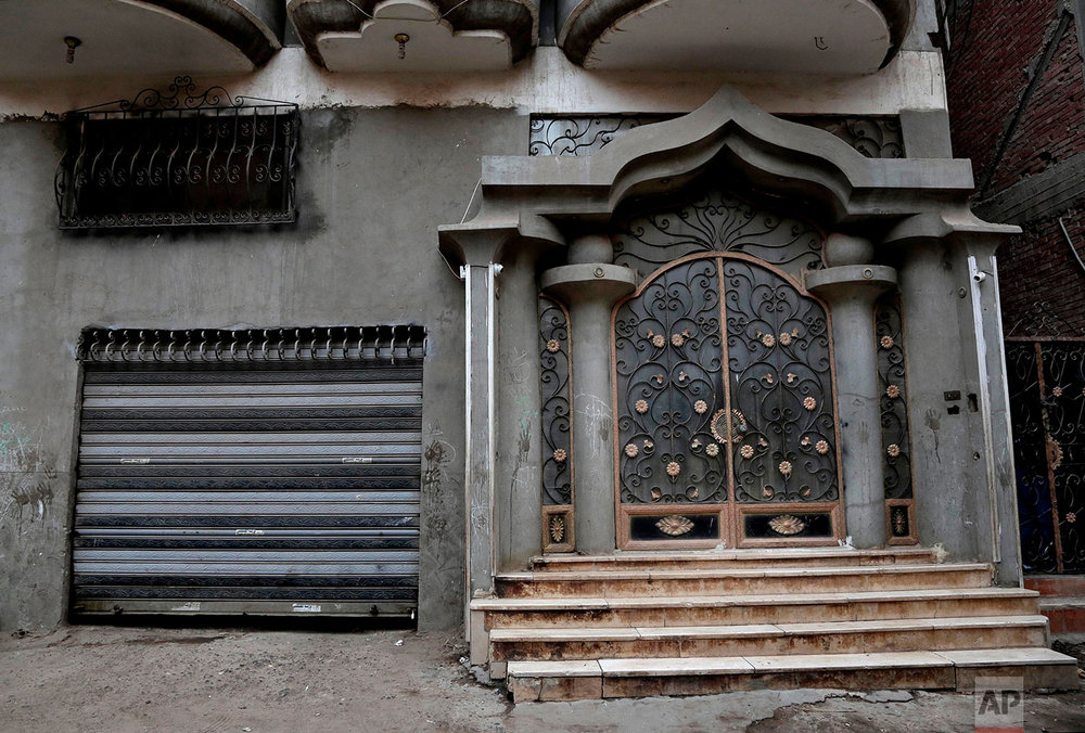 The entrance of the building where Salah grew up. (AP Photo/Nariman El-Mofty)