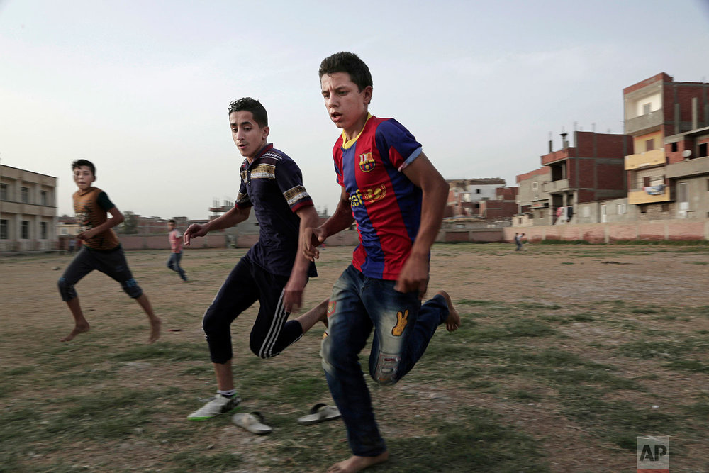 Boys play football at the sports and youth center, in Mohamed Salah's the Nile delta village of Nagrig, Egypt, May 2, 2018. (AP Photo/Nariman El-Mofty)