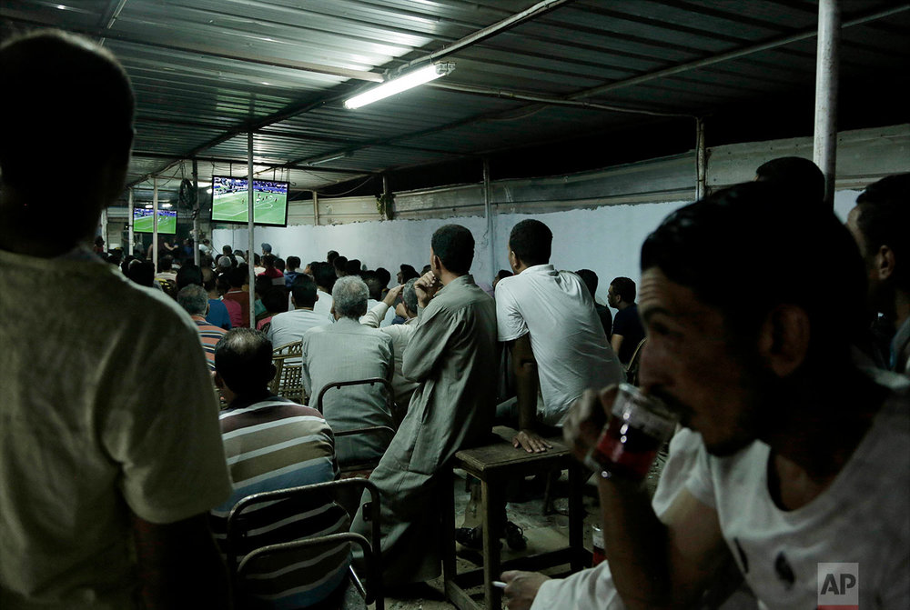 A crowd watches the Liverpool vs. Roma match at a cafe in Mohamed Salah's hometown Nile delta village of Nagrig, Egypt, May 2, 2018. (AP Photo/Nariman El-Mofty)