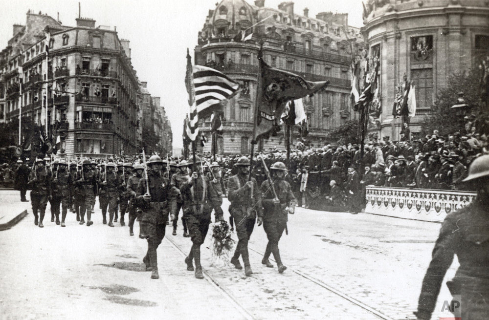 This photo provided by National World War I Museum and Memorial dated July 4, 1918 shows American troops in a Fourth of July parade in Paris, France. (National World War I Museum and Memorial via AP)