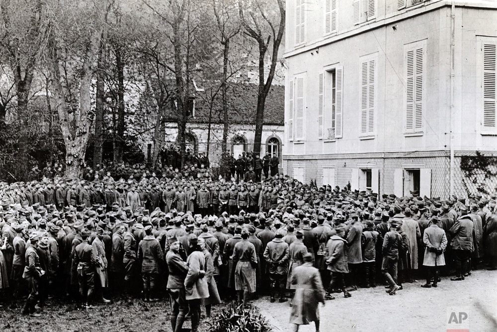 In this photo provided by National World War I Museum and Memorial and dated April 16, 1918, Gen. Pershing, center right, addresses officers of the First Division before they leave for the line in Chaumont-en-Vexin, 60 kilometers (38 miles) north of Paris, France. (National World War I Museum and Memorial via AP)