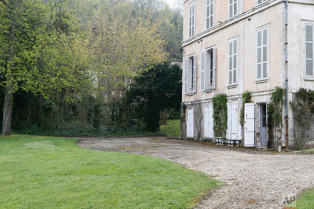 This photo dated April 14, 2018, shows an estate in Chaumont-en-Vexin, 60 kilometers (38 miles) north of Paris, France. (AP Photo/Laurent Rebours)