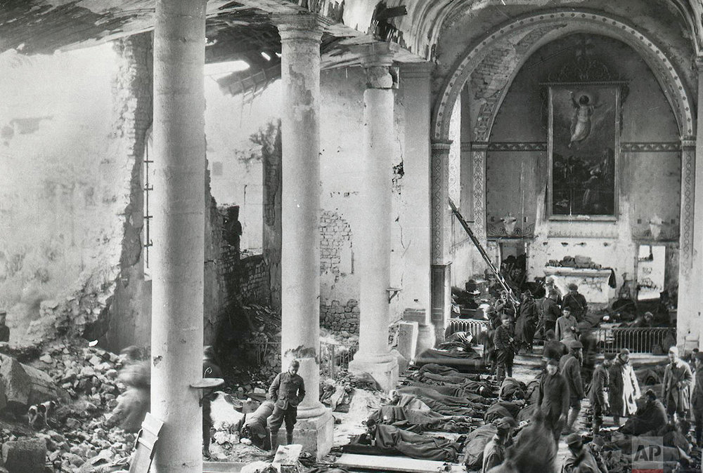 This photo provided by National World War I Museum and Memorial dated Sept. 20, 1918 shows the wounded being treated by the 110th Sanitary Train, 137th Field Hospital, 35th Div., in an old church in Neuvilly-en-Argonne, eastern France. (National World War I Museum and Memorial via AP)