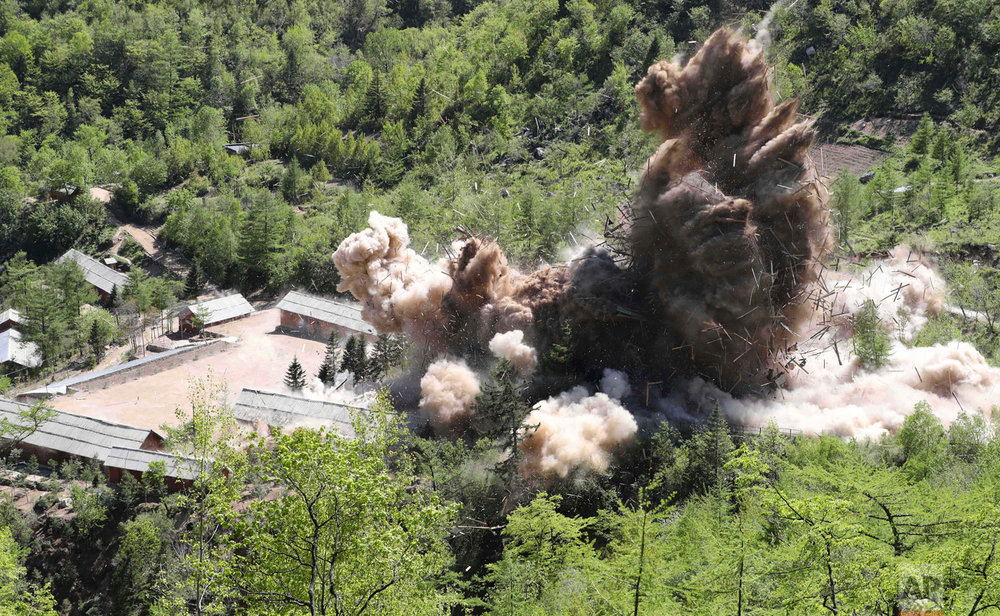 "Command post facilities of North Korea's nuclear test site are exploded in Punggye-ri, North Korea on Thursday, May 24, 2018. North Korea said Friday that it's still willing to sit for talks with the United States ""at any time, (in) any format,"" a remarkably restrained and diplomatic response, from a nation noted for its proud belligerence, to U.S. President Donald Trump's abrupt cancellation of a summit with the North's autocratic leader, Kim Jong Un. (Korea Pool/Yonhap via AP)"