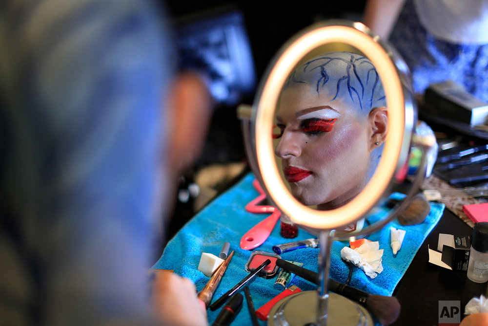 Elias, 24, who goes by the stage name of Melanie Coxxx, applies make-up at his home during Beirut Pride week, May 13, 2018, Tabarja, Lebanon.  (AP Photo/Hassan Ammar)