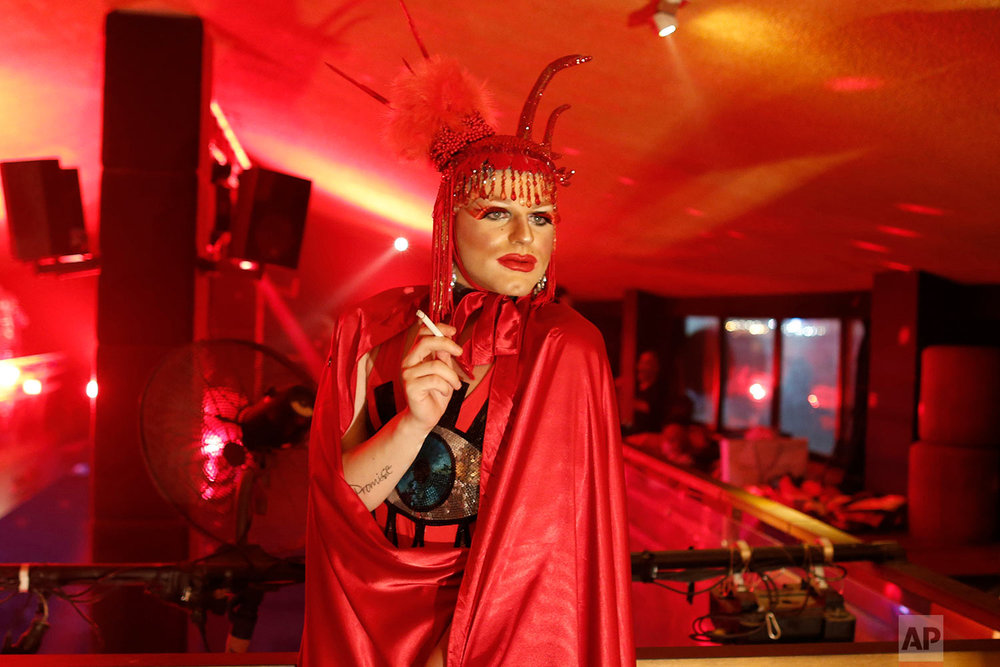 In this picture taken Sunday, May 13, 2018, Elias, 24, who goes by the stage name of Melanie Coxxx, smokes a cigarette before performing in a Sunday drag queen show, called the drag ball, during Beirut Pride week, north of the capital Beirut, Lebanon. (AP Photo/Hassan Ammar)