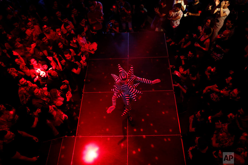 In this picture taken Sunday, May 13, 2018, Drag queen Hoedy performs during a Sunday drag queen show, called the drag ball, during Beirut Pride week, north of the capital Beirut, Lebanon. (AP Photo/Hassan Ammar)