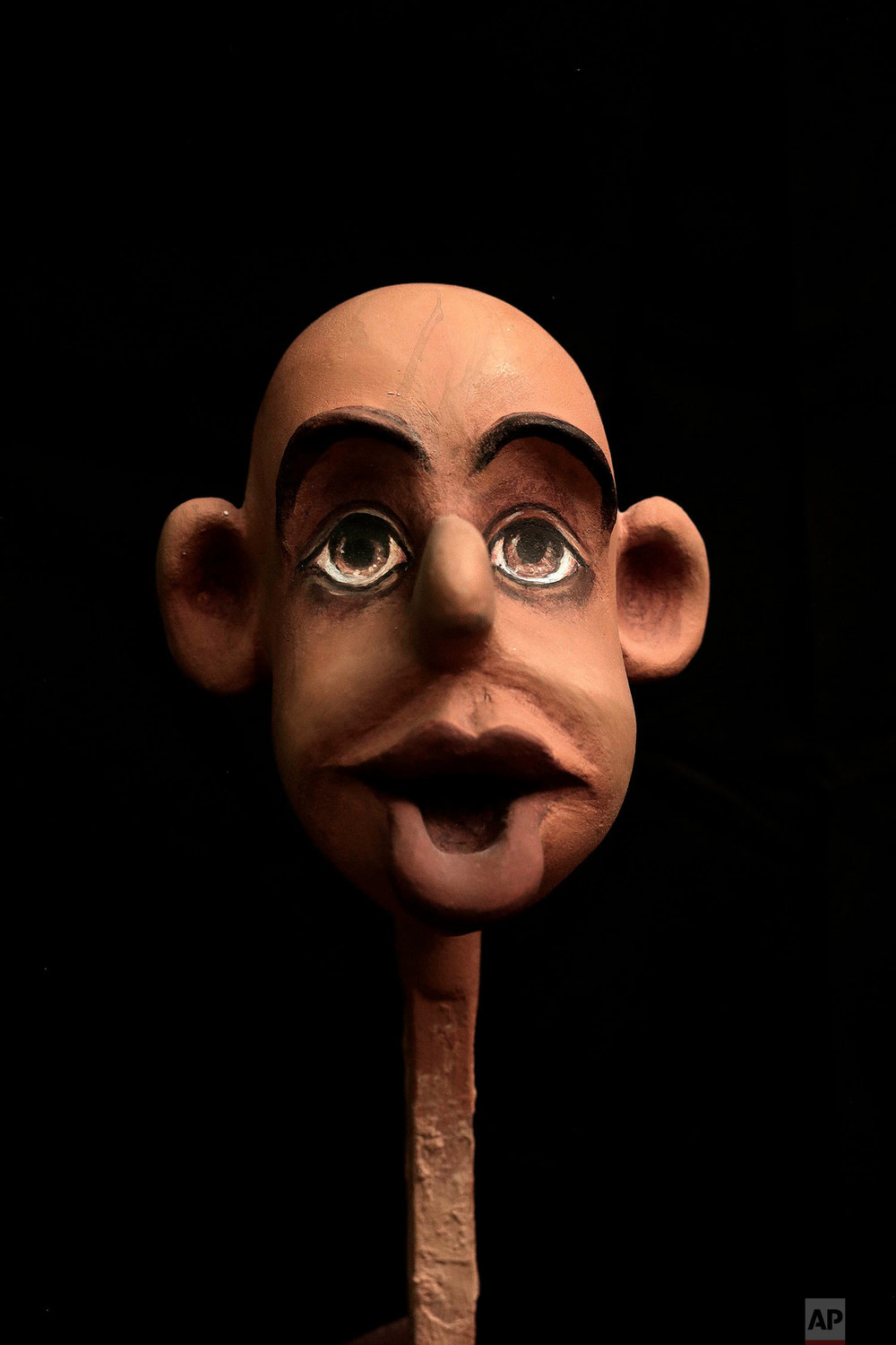 This April 24, 2018 photo, shows the face of a puppet in the process being made by Egyptian artist Mohamed Fawzi Bakkar, at his workshop, in Cairo, Egypt. Bakkar designs and builds marionettes from scratch, hoping to revive a traditional art. The 32-year-old spends hours or even days designing puppets inspired by Egyptian life -- farmers, street vendors, butchers and the occasional celebrity. (AP Photo/Nariman El-Mofty)