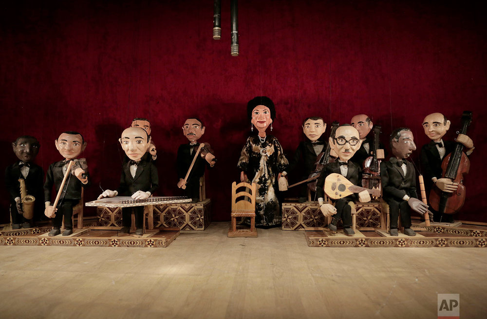 Marionettes of Umm Kalthoum, the most famed singer of classical Arabic music, and her band, made by Egyptian artist Mohamed Fawzi Bakkar, perform at the El Sawy Cultural Center, in Cairo, Egypt, May 3, 2018.  (AP Photo/Nariman El-Mofty)