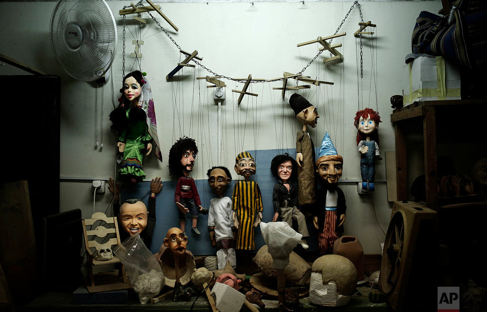 Puppets hang on the wall at the workshop of Egyptian artist Mohamed Fawzi Bakkar, in Cairo, Egypt, April 24, 2018. Bakkar designs and builds marionettes from scratch, hoping to revive a traditional art. (AP Photo/Nariman El-Mofty)
