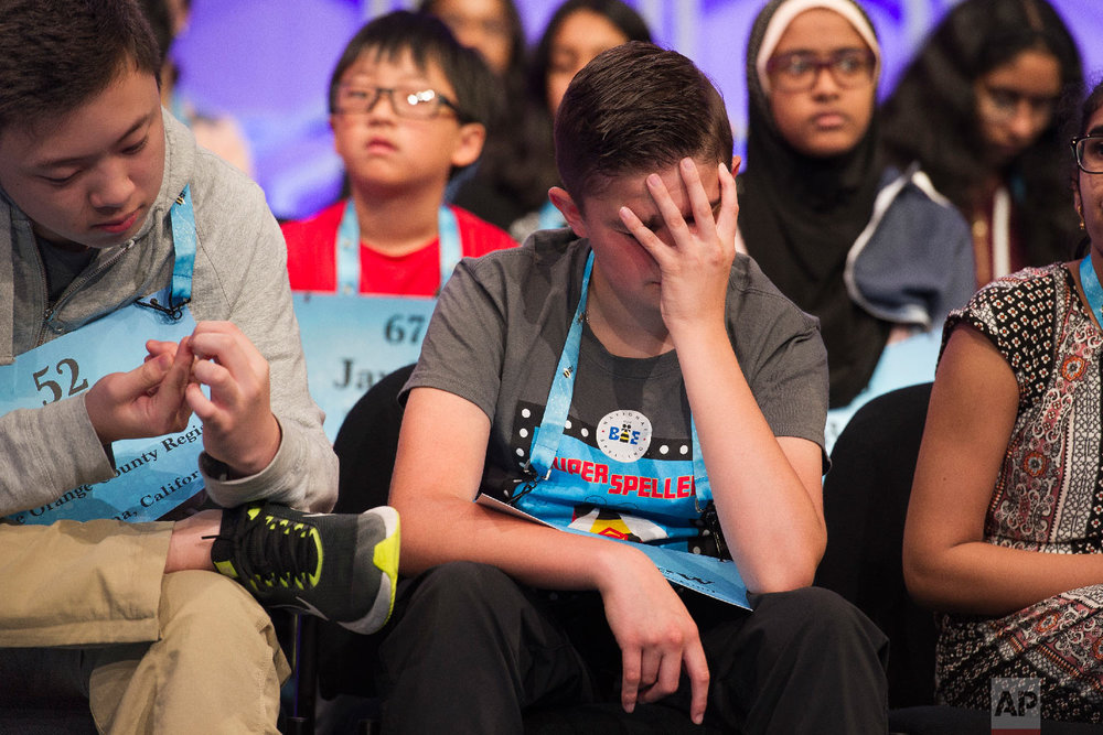 Winston Zuo, 13, from Yorba Linda, Calif., left, and Matthew Rodgers, 13, from Severance, Colo., wait to spell their word during the 3rd Round of the Scripps National Spelling Bee in Oxon Hill, Md., Wednesday, May 30, 2018. (AP Photo/Cliff Owen)