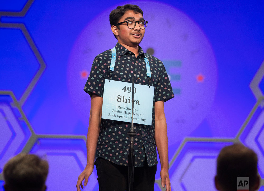 "Shiva Yeshlur, 13, from Rock Springs, Wyo., jumps into the air after correctly spelling ""diastrophism"" during the third round of the Scripps National Spelling Bee in Oxon Hill, Md., Wednesday, May 30, 2018. (AP Photo/Cliff Owen)"