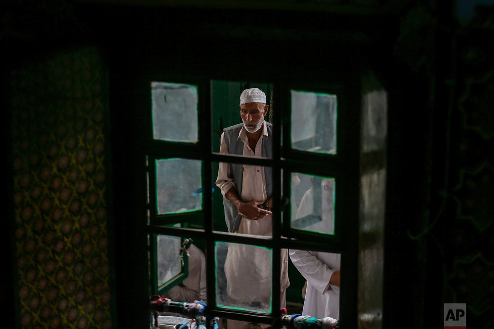 A Kashmiri man prays inside the Shah-e-Hamdan mosque during Ramadan in Srinagar, Indian controlled Kashmir, Friday, June 1, 2018. Islam's holiest month is a period of intense prayer, dawn-to-dusk fasting and nightly feasts. (AP Photo/Dar Yasin)