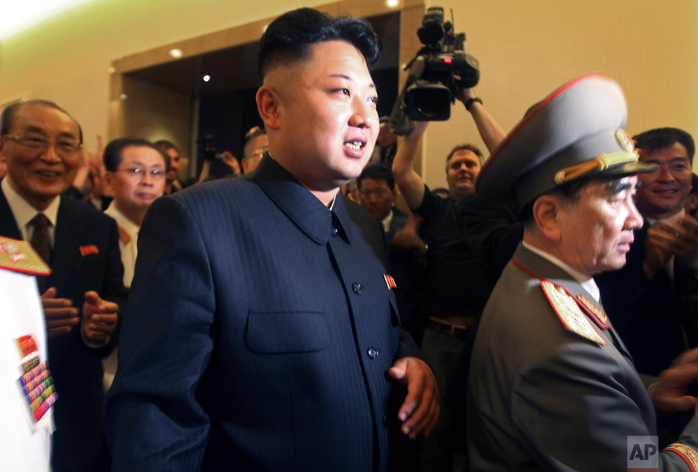 North Korean leader Kim Jong Un, center, is followed by his uncle Jang Song Thaek, second from left, and Yang Hyong Sop, left, vice president of the Presidium of North Korea's parliament, as he tours the newly opened Fatherland Liberation War Museum in Pyongyang on July 27, 2013. On Dec. 13, 2013, North Korea announced the execution Jang Song Thaek, long considered the country's No. 2 power, calling Kim's former mentor a traitor who tried to overthrow the state. (AP Photo/Wong Maye-E)