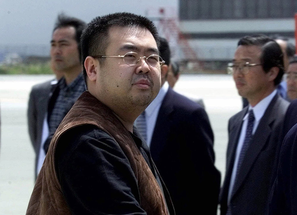 Kim Jong Nam, the eldest son of North Korean leader Kim Jong Il, looks back at a group of photographers before boarding a plane to Beijing at Narita international airport near Tokyo, on May 4, 2001. Kim was fatally poisoned at Kuala Lumpur's airport on Feb. 13, 2017, while traveling under a pseudonym. (AP Photo/Shizuo Kambayashi)